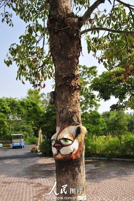 创意无限 深圳街头让人叫绝的逼真树体彩绘图片